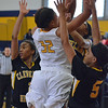 Paul DiCicco - The News-Herald<br /> Euclid's Raylon Harris going to the hoop against three Cleveland Heights defenders.