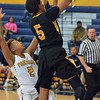 Paul DiCicco - The News-Herald<br /> Cleveland Heights' Iyanna Williams drives to the hoop early in the first quarter, with Euclid's Deoshanae Borden defending.