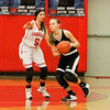 Barry Booher - The News-Herald<br /> Mentor's Maddy Moyer forces Amanda Apanavicius to pass off the ball.