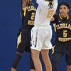 Paul DiCicco - The News-Herald<br /> Euclid's Constance Chapin attempts a 3-pointer in the second quarter against an outstretched Arion Nichols.