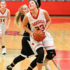 Barry Booher - The News-Herald<br /> Mentor's Nicole Heffington goes up strong against Lauryn Holm.