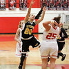 Barry Booher - The News-Herald<br /> Riverside's Gianna Fiore is fouled on her shot attempt by Mentor's Raegan Thompson.