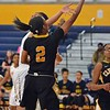 Paul DiCicco - The News-Herald<br /> Cleveland Heights' Arion Nichols scoops a shot under the defense of Raylon Harris.