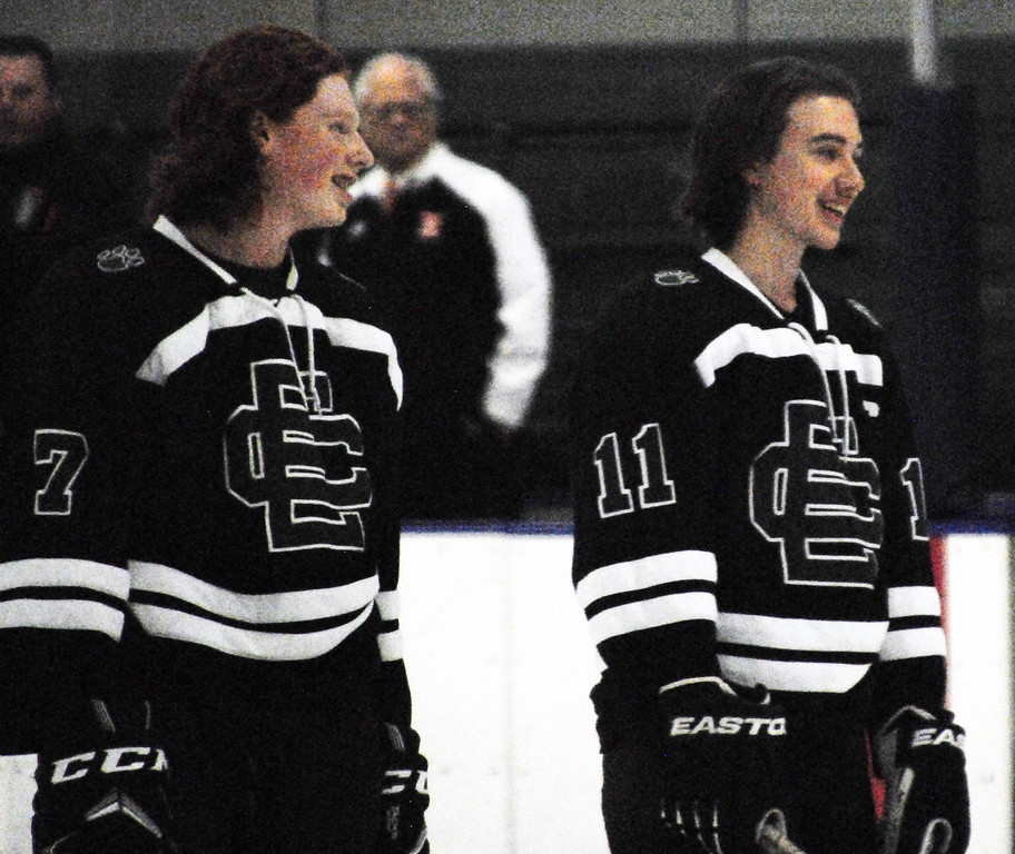 . Jon Behm - The Morning Journal<br> Elyria Catholic senior Drew Beck (11) smiles with teammate Riley Cunningham during player introductions prior to the Panthers\' Brooklyn District sectional semifinal showdown against Normandy on Feb. 18 at Brooklyn\'s John M. Coyne Recreation Center.