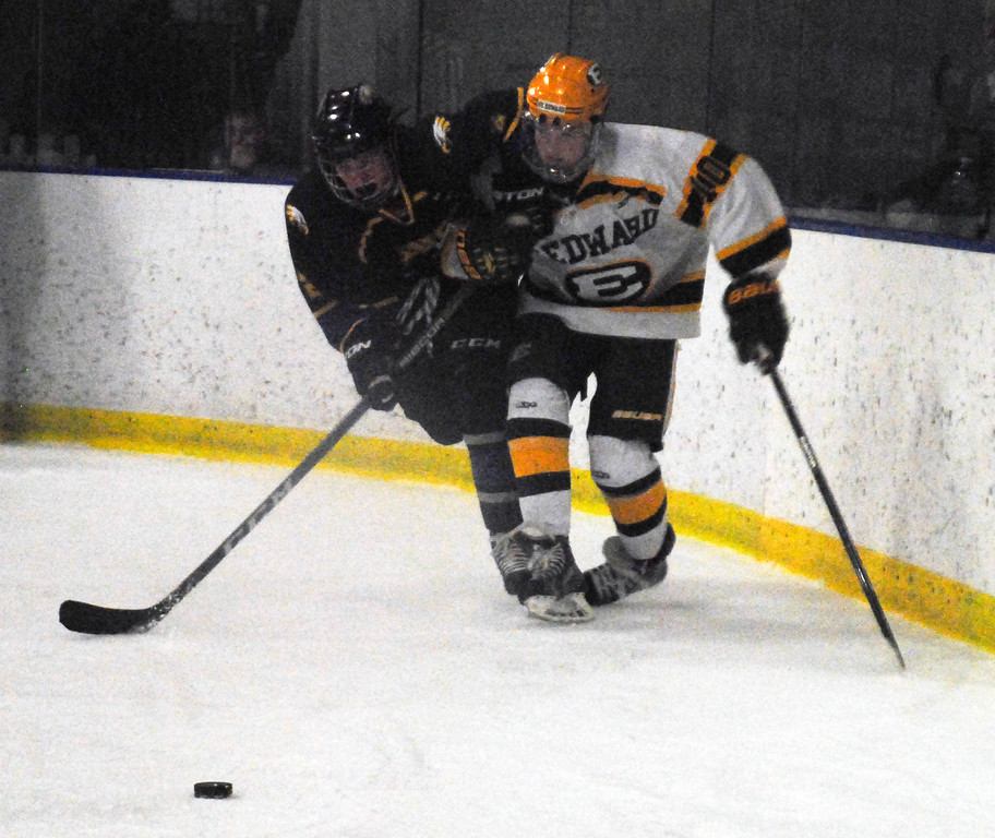 . Jon Behm - The Morning Journal<br> Avon\'s Cole Emerine works to fend off St. Edward\'s Ryan Willse during the first period of a Brooklyn District sectional semifinal on Feb. 18 at Brooklyn\'s John M. Coyne Recreation Center.