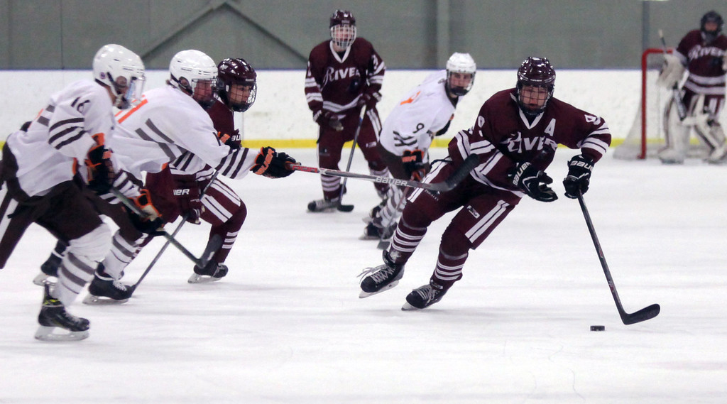 . Randy Meyers - The Morning Journal Ben Williams of Rocky River clears the puck near center ice during the first period against Padua on Sunday afternoon