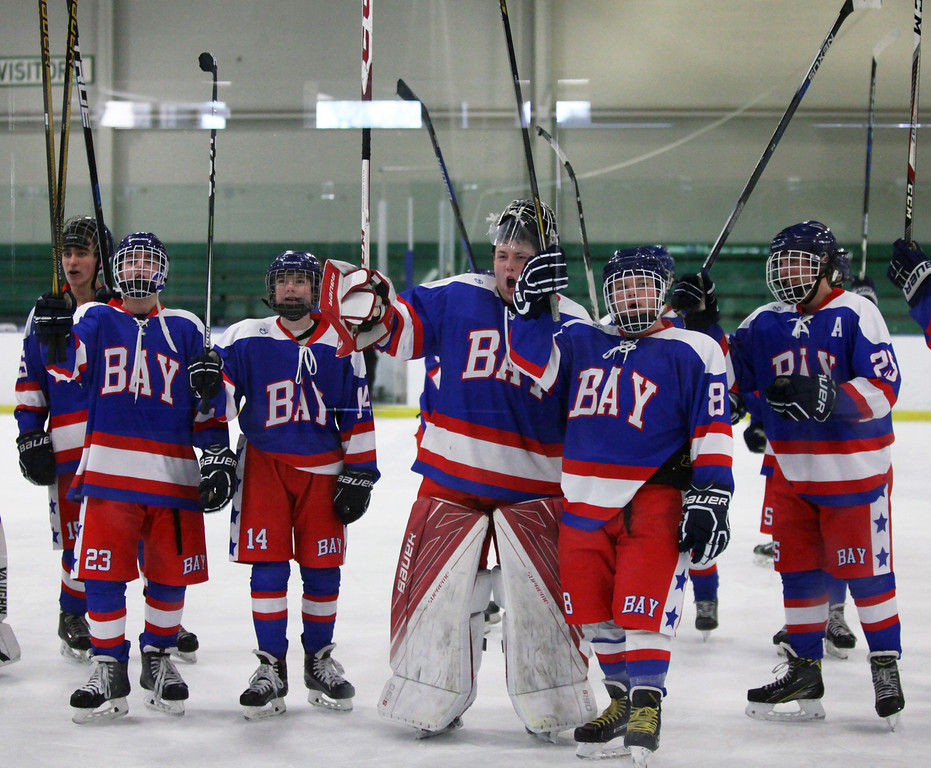. Randy Meyers - The Morning Journal Members of the Bay hockey team celebrate their sectional semifinal win over Olmsted Falls on Sunday with their fans