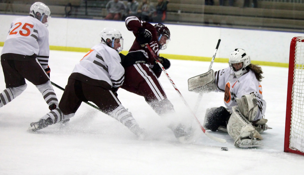 . Randy Meyers - The Morning Journal Padua goalie Lynsey Wallace blocks a shot on goal by Rocky River\'s Ted Steuber during the first period on Sunday afternoon.