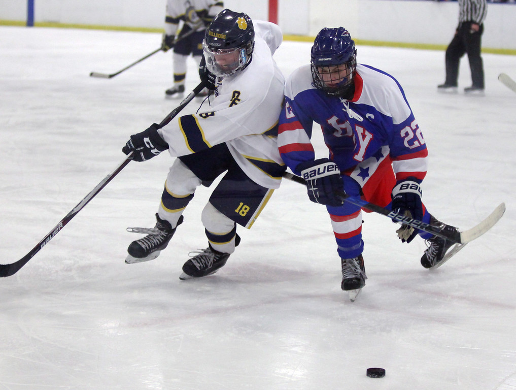 . Randy Meyers - The Morning Journal Bay\'s Jacob Saudino battles Cam Wilson of Olmsted Falls for a loose puck during Sunday\'s OHSAA sectional semifinal at Brooklyn