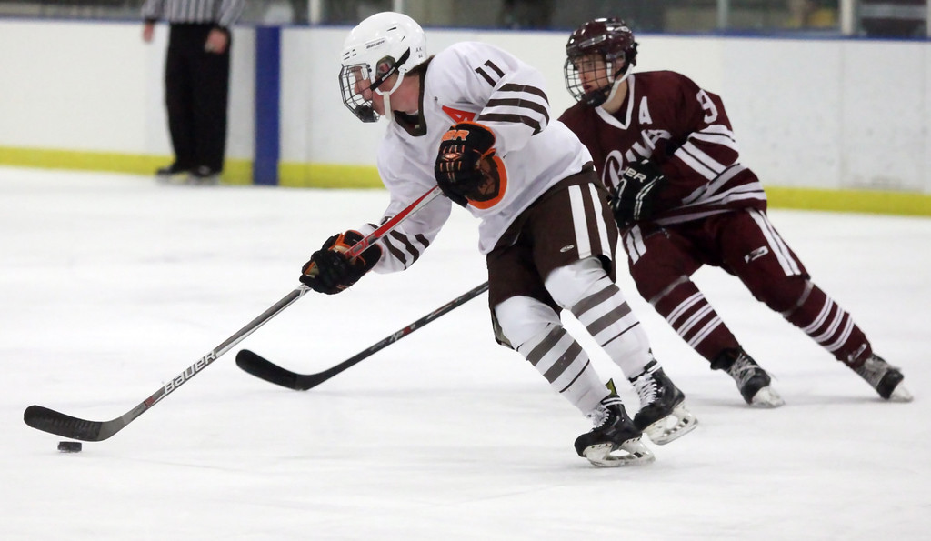 . Randy Meyers - The Morning Journal Padua\'s Ryan Kijel skates past Ben Williams of Rocky River during the first period of the OHSAA sectional finals on Sunday