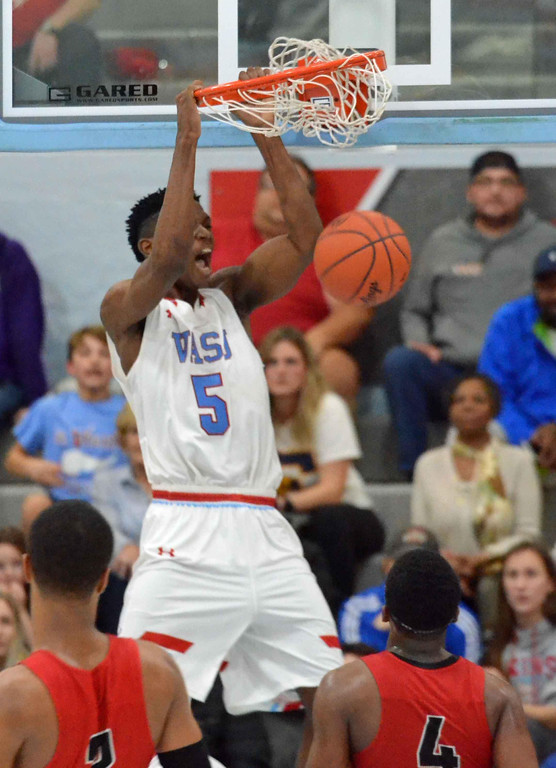 . Paul DiCicco - The News-Herald VASJ junior Latrace Jackson dunks off a rebound during the first overtime against Cornerstone Christian on Feb. 19.