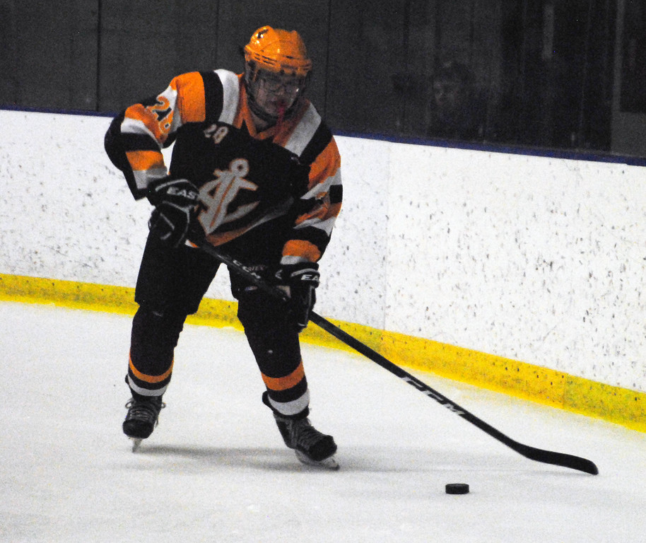 . Jon Behm - The Morning Journal<br> Avon Lake\'s Joey Kleinhenz looks to clear the puck against Rocky River during the first period of a Brooklyn District sectional final on Feb. 20 at Brooklyn\'s John M. Coyne Recreaction Center.