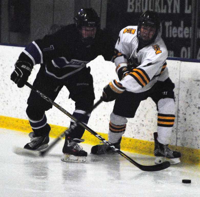 . Jon Behm - The Morning Journal<br> Midview\'s Robby Rodgers battles with St. Ignatius\' Eric Lile for possession of the puck during the first period of a Brooklyn District sectional final on Feb. 20 at Brooklyn\'s John M. Coyne Recreation Center.