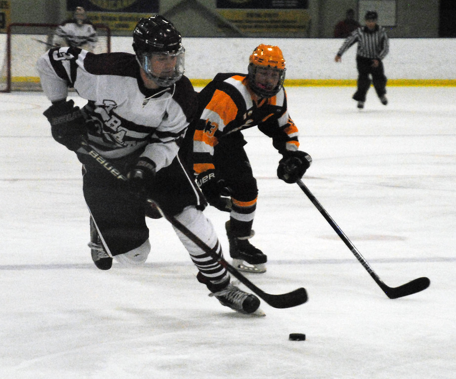 . Jon Behm - The Morning Journal<br> Rocky River\'s Ted Stueber skates into the offensive zone as Avon Lake\'s Tim Lubertozzi gives chase during the first period of a Brooklyn District sectional final on Feb. 20 at Brooklyn\'s John M. Coyne Recreaction Center.