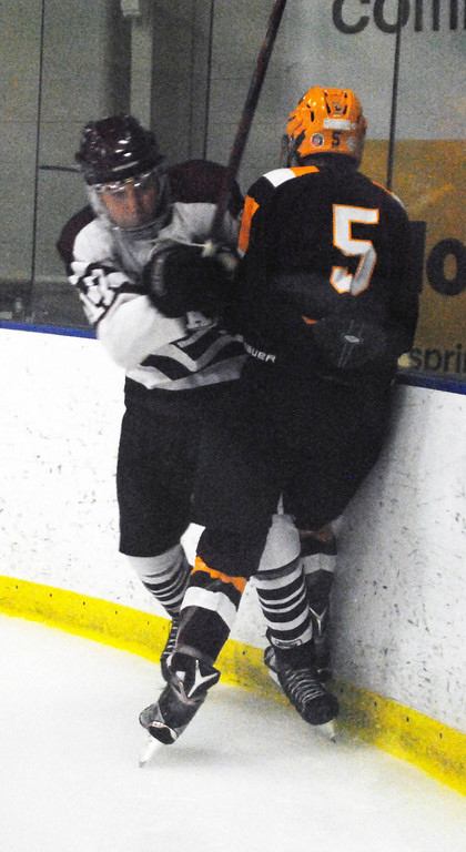. Jon Behm - The Morning Journal<br> Rocky River\'s Aiden Dempsey puts a hit on Avon Lake\'s Luke Farthing during the first period of a Brooklyn District sectional final on Feb. 20 at Brooklyn\'s John M. Coyne Recreaction Center.
