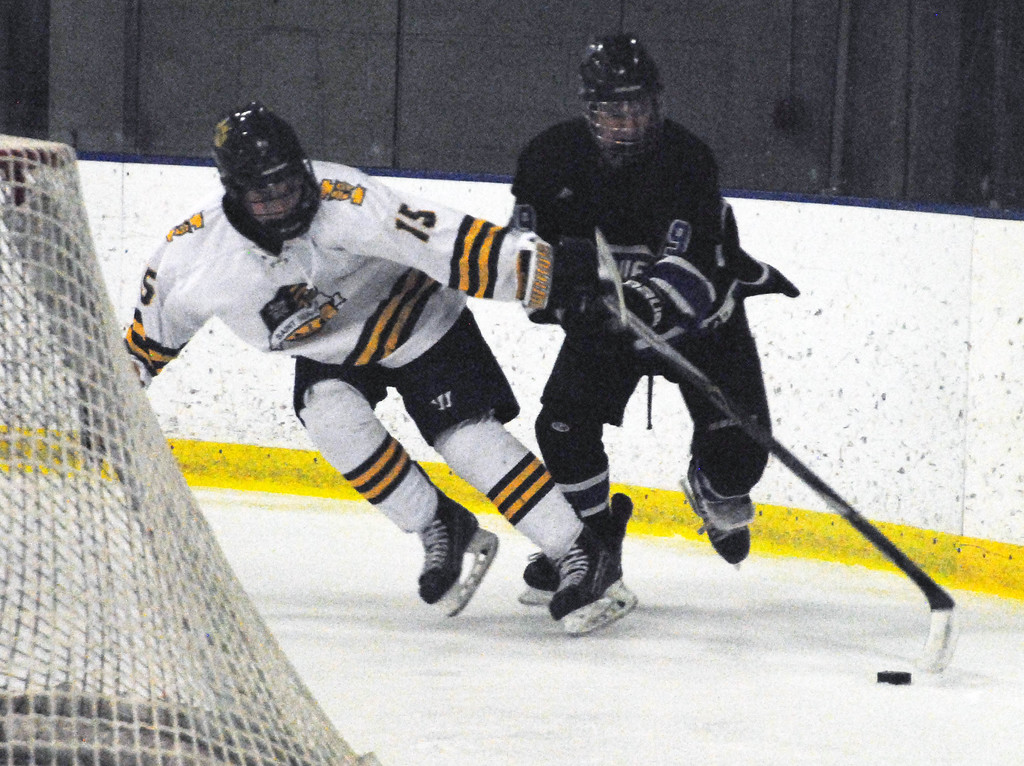 . Jon Behm - The Morning Journal<br> Midview\'s Jonathan Rodgers battles with St. Ignatius\' David Strick for possession of the puck during the first period of a Brooklyn District sectional final on Feb. 20 at Brooklyn\'s John M. Coyne Recreation Center.