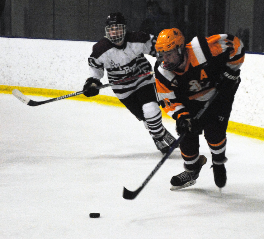 . Jon Behm - The Morning Journal<br> Avon Lake\'s Ti mLubertozzi brings the puck around net at Rocky River\'s Nolan Weaver gives chase during the first period of a Brooklyn District sectional final on Feb. 20 at Brooklyn\'s John M. Coyne Recreaction Center.