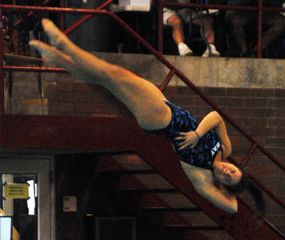 . Jon Behm - The Morning Journal<br> Bay\'s Mara Kinsey twists during the Division II girls state competition on Feb. 21 at C.T. Branin Natatorium in Canton.