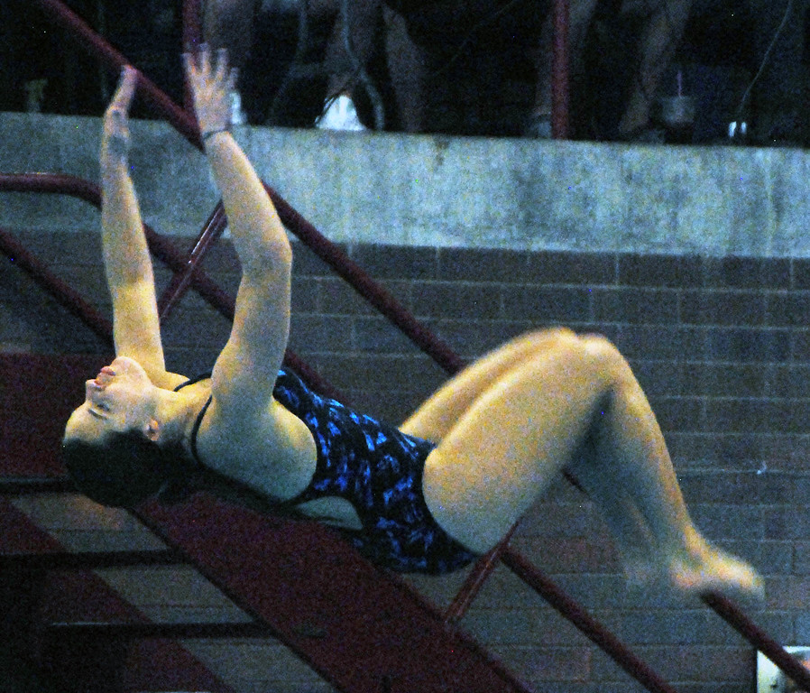 . Jon Behm - The Morning Journal<br> Bay\'s Mara Kinsey flips during the Division II girls state competition on Feb. 21 at C.T. Branin Natatorium in Canton.