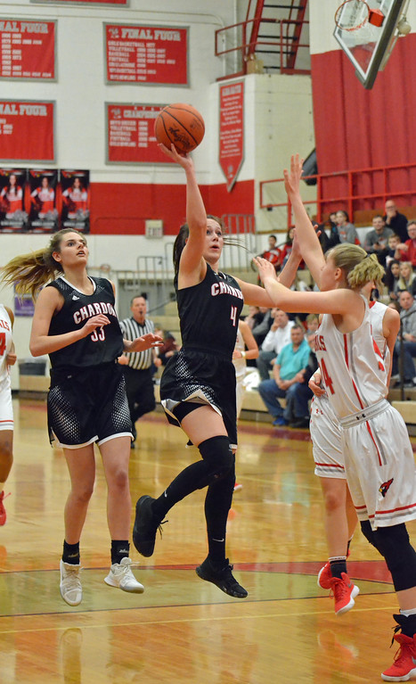 . Paul DiCicco - The News-Herald Chardon\'s Grace Bradley (4) driving and floating a shot over a Mentor defender in the second half.
