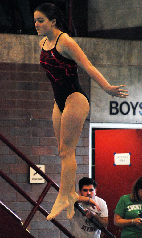 . Jon Behm - The Morning Journal<br> Elyria junior Angelina Cagle springs from the board at the Division I girls state diving competition on Feb. 22 at the C.T. Branin Natatorium in Canton. Cagle placed 20th with a score of 262.65.
