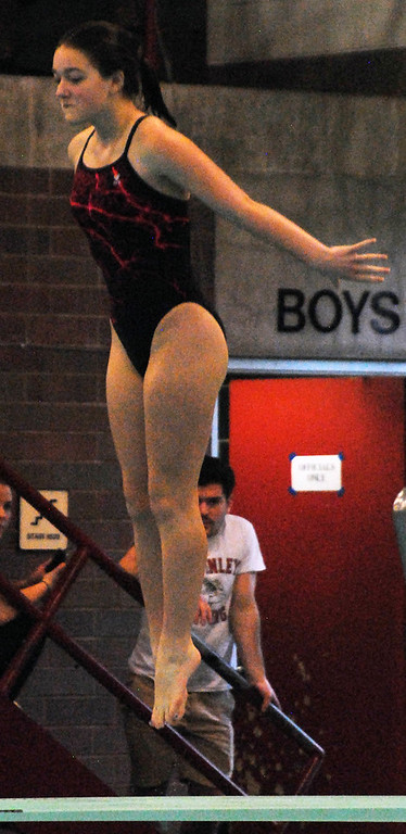 . Jon Behm - The Morning Journal<br> Elyria junior Angelina Cagle springs from the board during the Division I girls state diving competition on Feb. 22 at the C.T. Branin Natatorium in Canton. Cagle placed 20th with a score of 262.65.