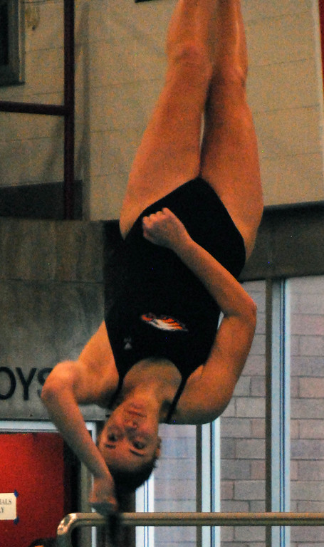 . Jon Behm - The Morning Journal<br> Avon sophomore Amanda Socha flips during a dive at the Division I girls state diving competition on Feb. 22 at the C.T. Branin Natatorium in Canton. Socha placed 18th with a score of 277.60.