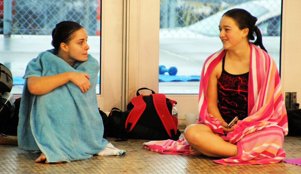 . Jon Behm - The Morning Journal<br> Avon sophomore Amanda Socha, left, and Elyria junior Angelina Cagle talk between dives at the Division I girls state diving competition on Feb. 22 at the C.T. Branin Natatorium in Canton. Socha placed 18th with a score of 277.60, while Cagle placed 20th with a score of 262.65.