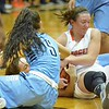 Paul DiCicco - The News-Herald<br /> Two Kenston Bombers fight a North Ranger for the loose ball.