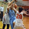 Paul DiCicco - The News-Herald<br /> North's smothering defense stops the drive of Kenston's Corenna Maynard in her tracks.