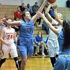 Paul DiCicco - The News-Herald<br /> Kenston's Madelyn Spehn blocking a shot of Ally Lako late in the second quarter.