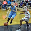 Paul DiCicco - The News-Herald<br /> Kenston's Julie Hajdu trying to turn the corner, unsuccessfully against Ananda Lyons stellar defense.