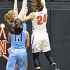 Paul DiCicco - The News-Herald<br /> North's Samantha Pirosko shooting over an outstretched Kenston defender.