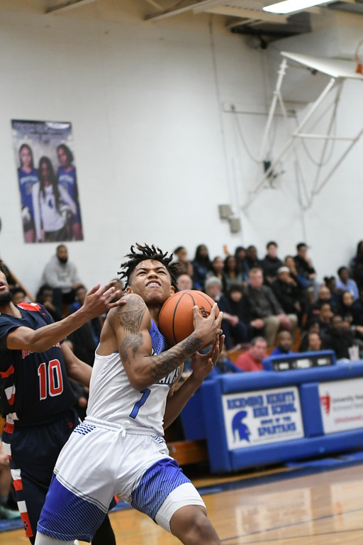 . Patrick Hopkins - The News-Herald Action from the Lincoln-West-Ricmond Heights game Feb. 24