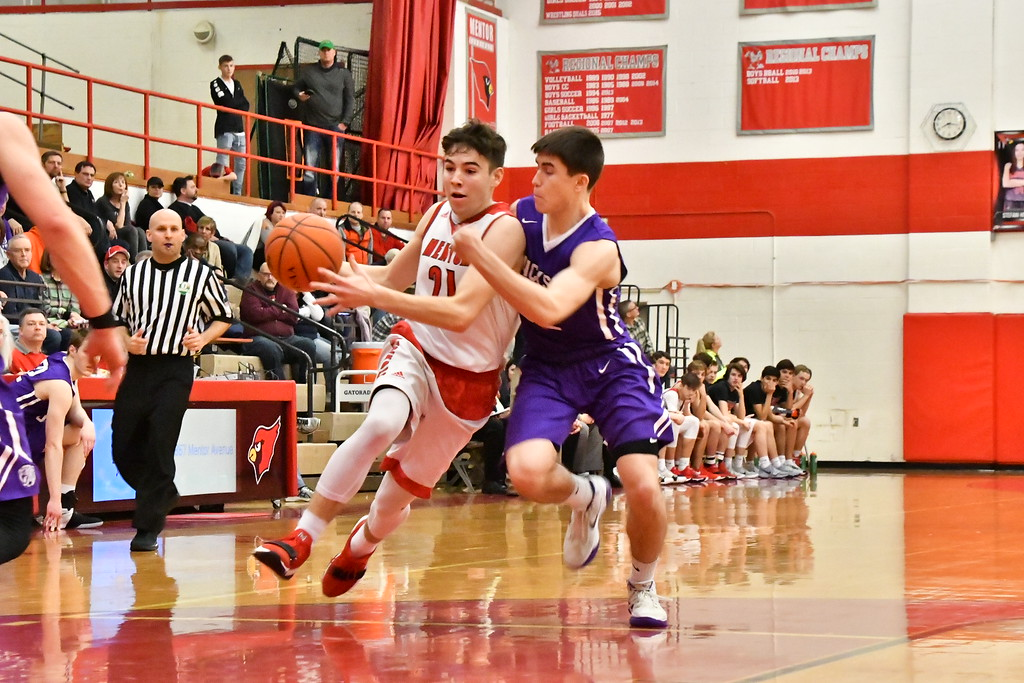 . Brittany Chay - The News-Herald Action from the Massillon Jackson-Mentor boys basketball game Feb. 24.