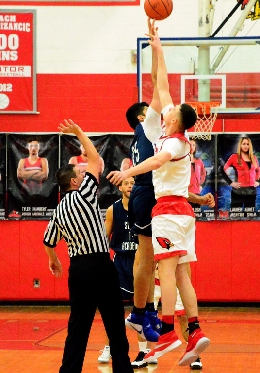 . Brittany Chay - The News-Herald Mentor\'s vies for the tip off against Spire during the Cardinals\' victory on Feb. 25.