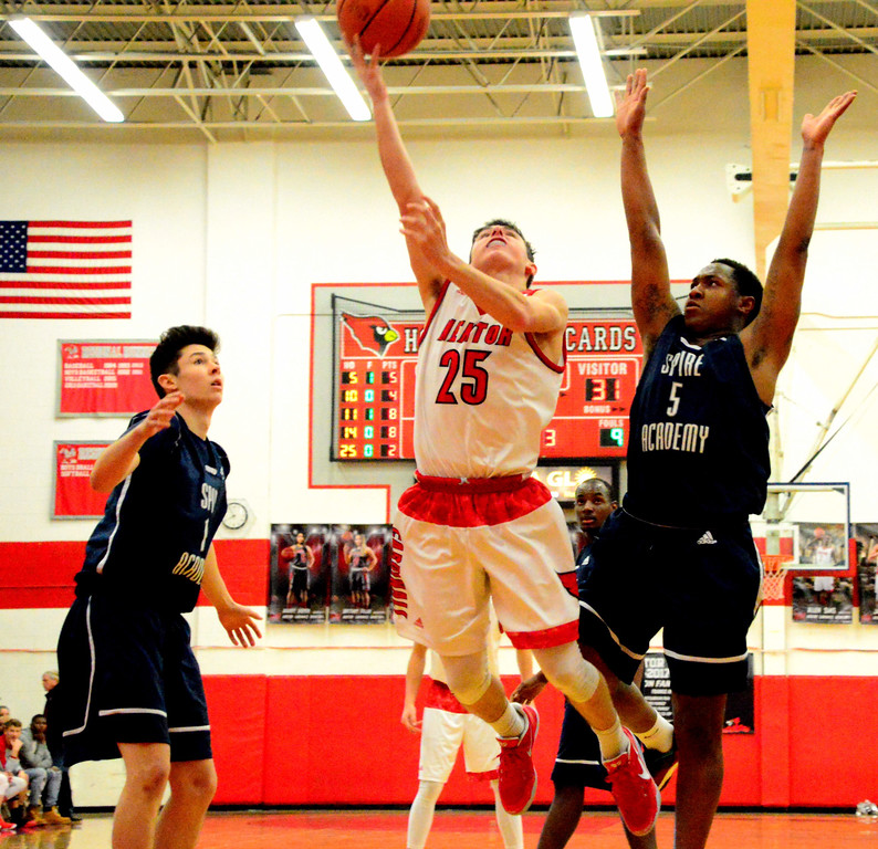 . Brittany Chay - The News-Herald Mentor\'s Luke Floriea shoosts against the Spire defense during the Cardinals\' victory on Feb. 25.