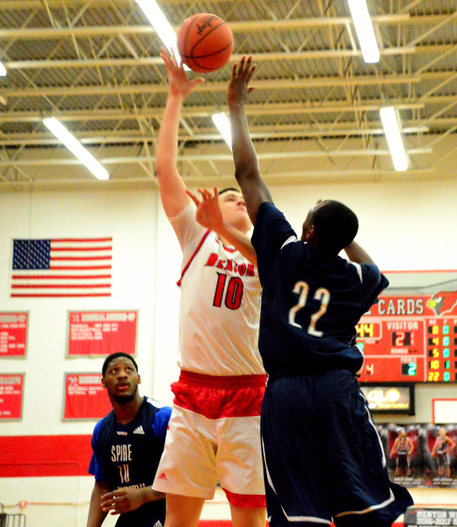 . Brittany Chay - The News-Herald Mentor\'s Xavier Cheek shoots against the Spire defense during the Cardinals\' victory on Feb. 25.