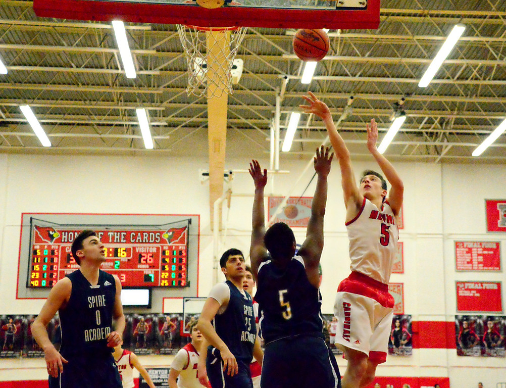 . Brittany Chay - The News-Herald Mentor\'s Jack Korsok shoots against Spire during the Cardinals\' victory on Feb. 25.