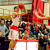 Brittany Chay - The News-Herald<br /> Mentor's Shane Zalba shoots in front of Spire's Jesse Davis during the Cardinals' victory on Feb. 25.