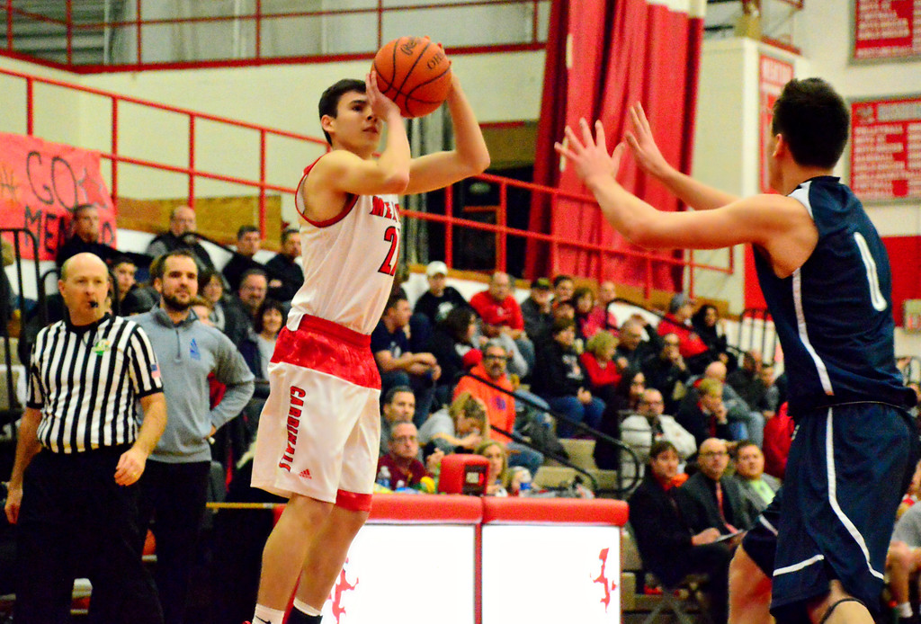 . Brittany Chay - The News-Herald Mentor\'s Shane Zalba shoots in front of Spire\'s Jesse Davis during the Cardinals\' victory on Feb. 25.