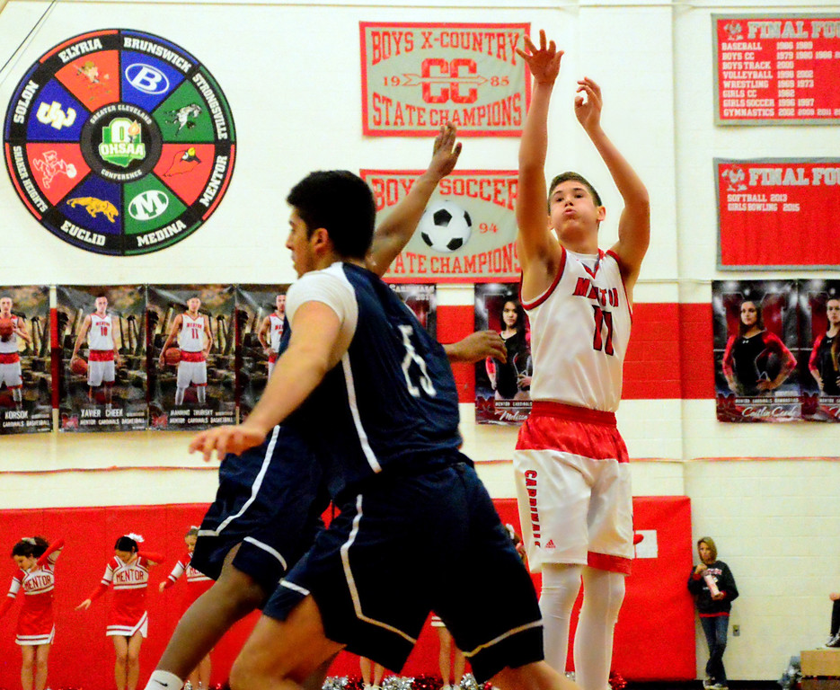 . Brittany Chay - The News-Herald Mentor\'s Manning Trubisky shoots a 3-pointer against Spire during Cardinals\' victory on Feb. 25.