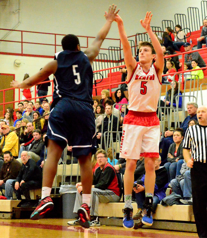 . Brittany Chay - The News-Herald Mentor\'s Jack Korsok shoots against Spire\'s Jojo Staton during the Cardinals\' victory on Feb. 25.