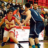 Brittany Chay - The News-Herald<br /> Mentor's Jack Korsok dribbles against Spire during the Cardinals' victory on Feb. 25.