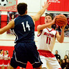 Brittany Chay - The News-Herald<br /> Mentor's Manning Trubisky works against Spire's Iain McLaughlin during Cardinals' victory on Feb. 25.