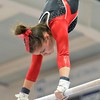 Paul DiCicco - The News-Herald<br /> Mentor's Caitlyn Coode performing her routine on the Uneven Parallel Bars at the 2017 OHSAA Northeast Ohio District Meet at West Geauga High School on Feb. 25.