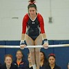 Paul DiCicco - The News-Herald<br /> Mentor's Alyssa Taglieri performing her routine on the Uneven Parallel Bars at the 2017 OHSAA Northeast Ohio District Meet at West Geauga High School on Feb. 25.