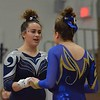 Paul DiCicco - The News-Herald<br /> West Geauga's Samantha Ange and NDCL's Tara Soria geve each other encouragement during the Vault exercise.