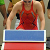 Jon Behm - The Morning Journal<br /> Rocky River senior Laura Banks climbs the block ahead of her 100 breaststroke swim at the D-I State meet on Feb. 25.