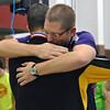 Jon Behm - The Morning Journal<br /> Avon coach Sean Hicks, left, and senior Ben Brooks share a moment after Hicks presented Brooks with his second-place medal for the 100 breaststroke at the D-I State swim meet at C.T. Branin Natatorium in Canton on Feb. 25.